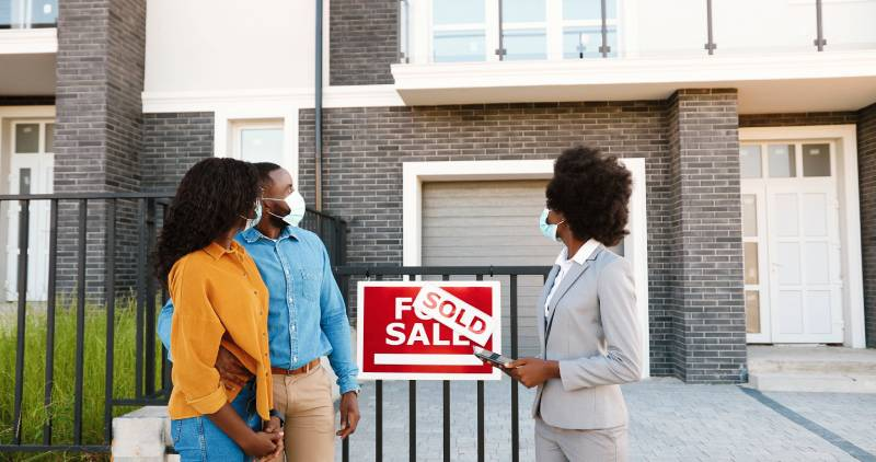 pros cons buying house